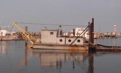 Dredger at work in Utsch's Marina
